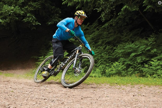 Lean the bike on flat turns more than your body for maximum traction