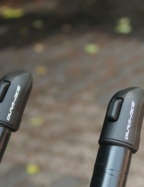 Shimano has a few different Di2 configurations for extension shifting. Some have two buttons on each. This set-up is similar to the sprint shifters, with one button on either side controlling shifting in one direction on the rear derailleur