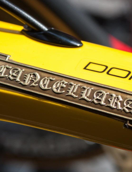 There's more artistic embossed detailing on Cancellara's yellow Trek Domane, this time for the rider's name badge