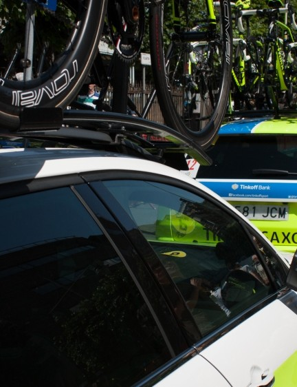 Every day of the Tour starts with a seemingly endless procession of bike-topped team cars and tinted-glass buses