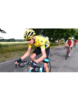 Chris Froome (Team Sky) trails Tony Martin (Etixx - Quick-Step) by 12 seconds following stage 4