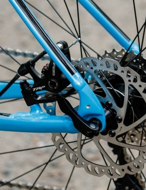 The rear brake caliper is tucked within the rear triangle and away from heel rub