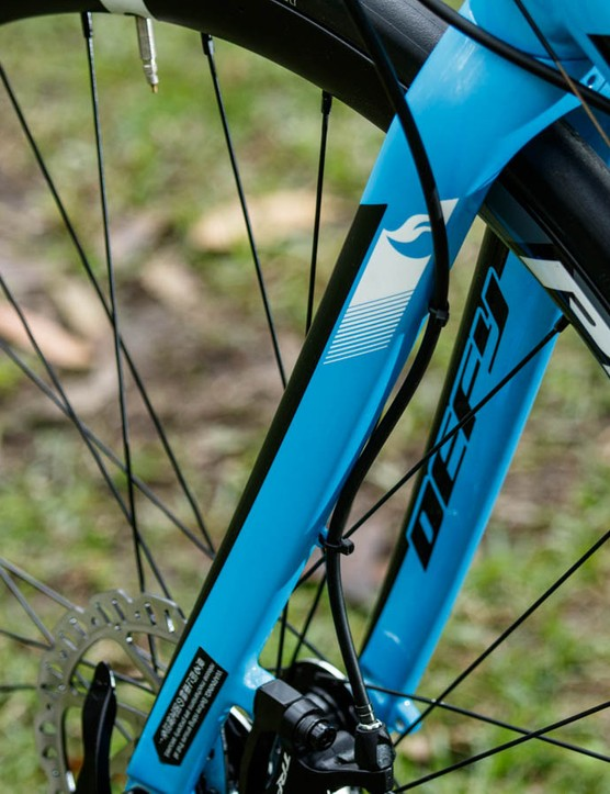 The front brake cable runs down the back edge of the fork and is held in place with cable ties