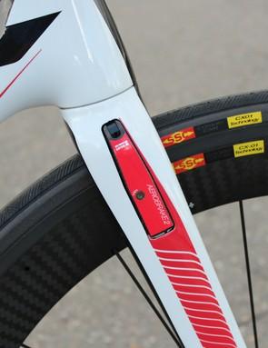 The front brake is basically a V-brake, tucked inside the fork