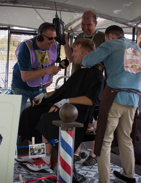 AG2R's Jan Bakelants multitasks before the start of stage three