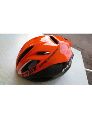 The ultra-limited edition orange Mandela Day Rivale helmet as worn by the team for a single stage