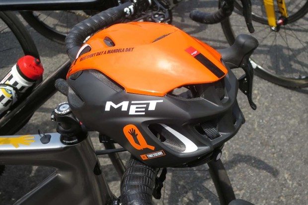 Each of the team's orange Mandela Day helmets will be signed and auctioned to raise funds towards their 5,000-bike goal