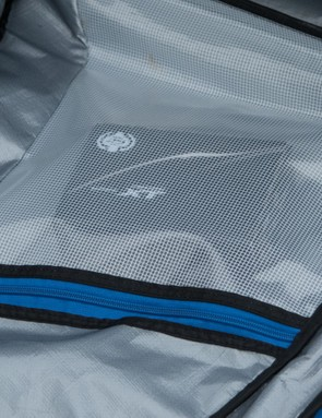 The largest of the three zippered pockets sits within the opening flap