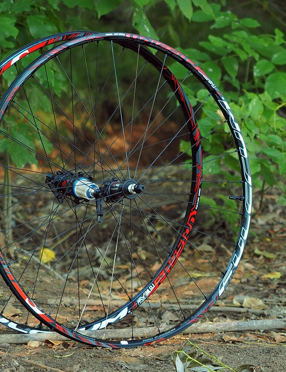 The Fulcrum Red Passion wheels prioritize low weight with a shallow, tubeless-compatible aluminium rim that's milled out between the spoke holes