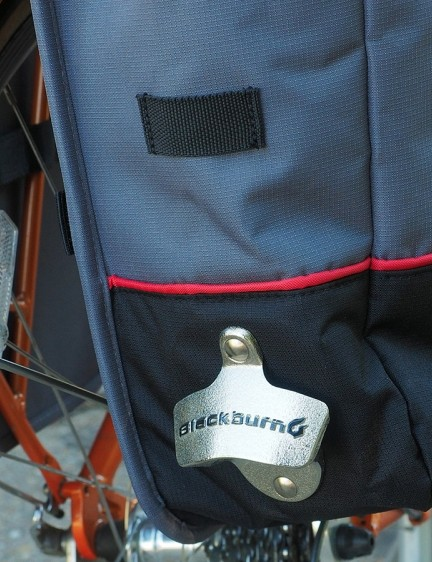 Yep, of course there's a bottle opener built right in - and a strap to attach a rear light
