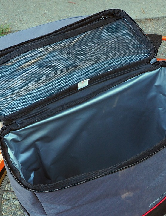 The insulated body is just about the right size for standard grocery bags while there's a mesh pocket up top for smaller items