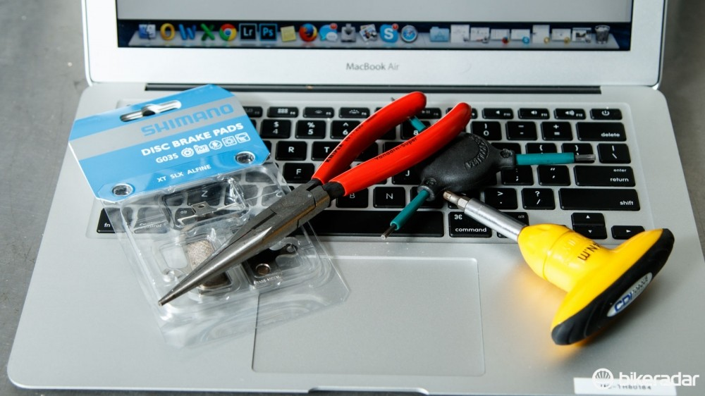 Tools and computers are likely a common sight in many modern home workshops