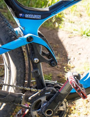 Giant Factory racer Josh Carlson was getting his air shock swapped out for a coil prior to stage 1
