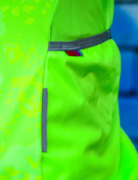 Reflective details on the vest increase visibility. Mesh panels benefit breathability