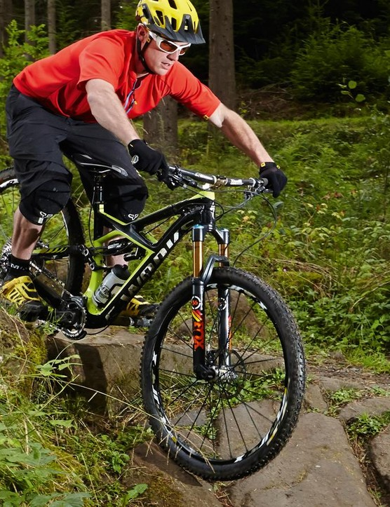 Extend your arms to allow your front wheel to drop away from you