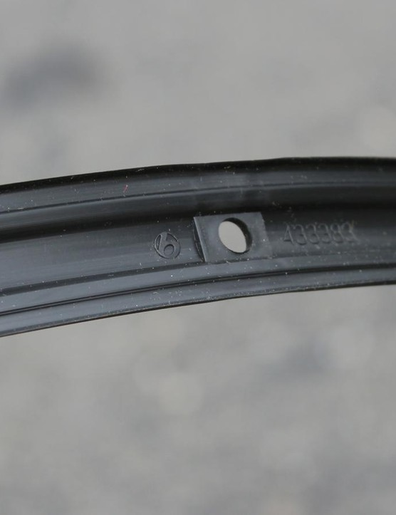 These rim strips snap into place, then require a little further seating with a tire lever. Changing tires can mean having to install a new rim strip as well