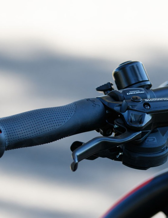 Ergonomic grips make for comfy hands, and large bar ends will prevent the bars from being damaged should the bike fall