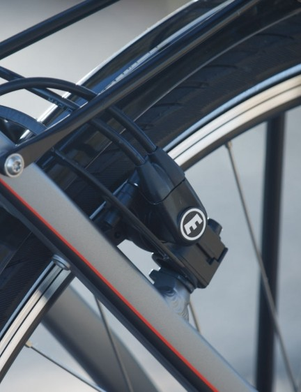 In addition to the coaster brake, the Corratec commuter also includes front and rear Magura HS11 hydraulic rim brakes