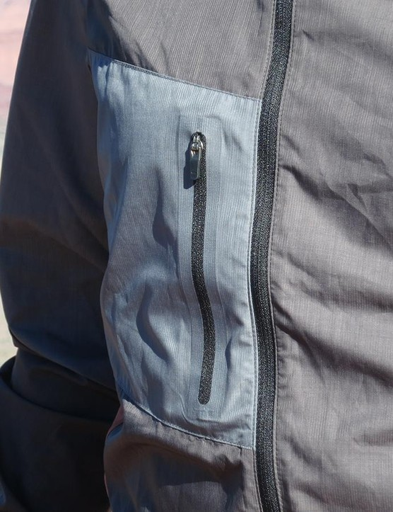 The Wind Jacket can be packed into the chest pocket, but the one-sided zipper doesn't allow it to be zipped shut