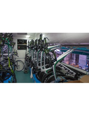 Inside the bus, one side is devoted to Fuji Norcom TT bikes