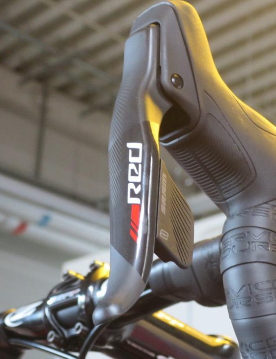 The new slender Red eTap levers feature carbon brake levers and retain reach adjust from standard Red too