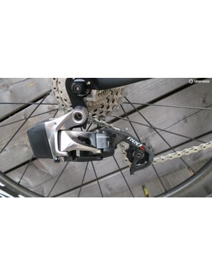 The rear derailleur features carbon cage plates and the pulleys are ceramic bearing equipped