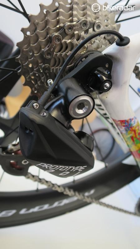 The wire exit on the FSA rear derailleur looks far more convincing than SRAM's efforts to hide its wireless design