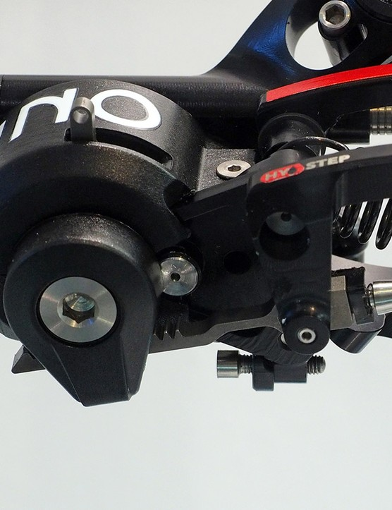 Indexing is done at the derailleur ends, with the rear one said to use an internal mechanism somewhat similar to what you might find in a wristwatch