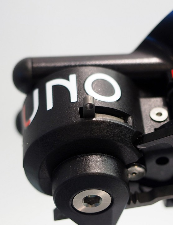 This small lever disconnects the indexing mechanism from the rest of the derailleur. In this way, wheel changes can be sped up and riders will be able to manually position the derailleur in the event of some sort of hydraulic failure (like a torn hydraulic line)
