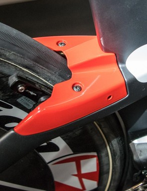 The rear brake is covered to maintain the flow of the frame