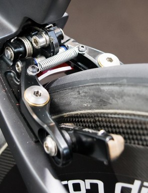 The rear brake uses a clever rotating cam wedge to actuate the caliper arms