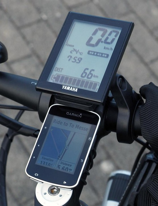 The Yamaha LCD display indicates current speed, battery power, motor output, air temperature, and time of day, plus estimated remaining range for a given assist setting. I preprogrammed the Garmin Edge 520 computer with my route to and from the show each day for easy navigating