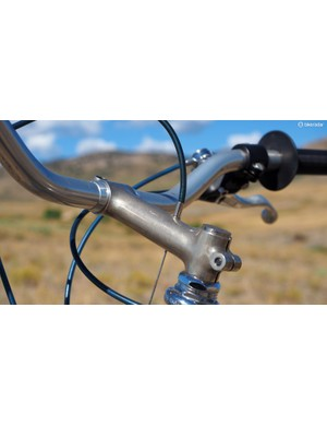 The matching stem clamps to a short stub that's brazed into the steerer tube - a sort of threadless/threaded hybrid