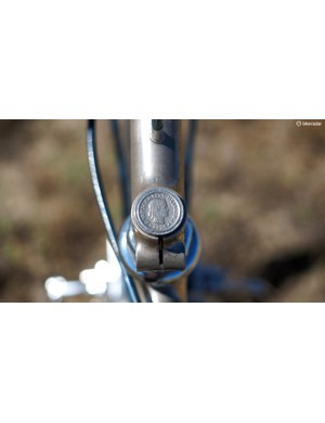A Swiss coin is brazed to the top of the steerer tube 'stub' and then nickel-plated along with the rest of the frame, fork, and stem