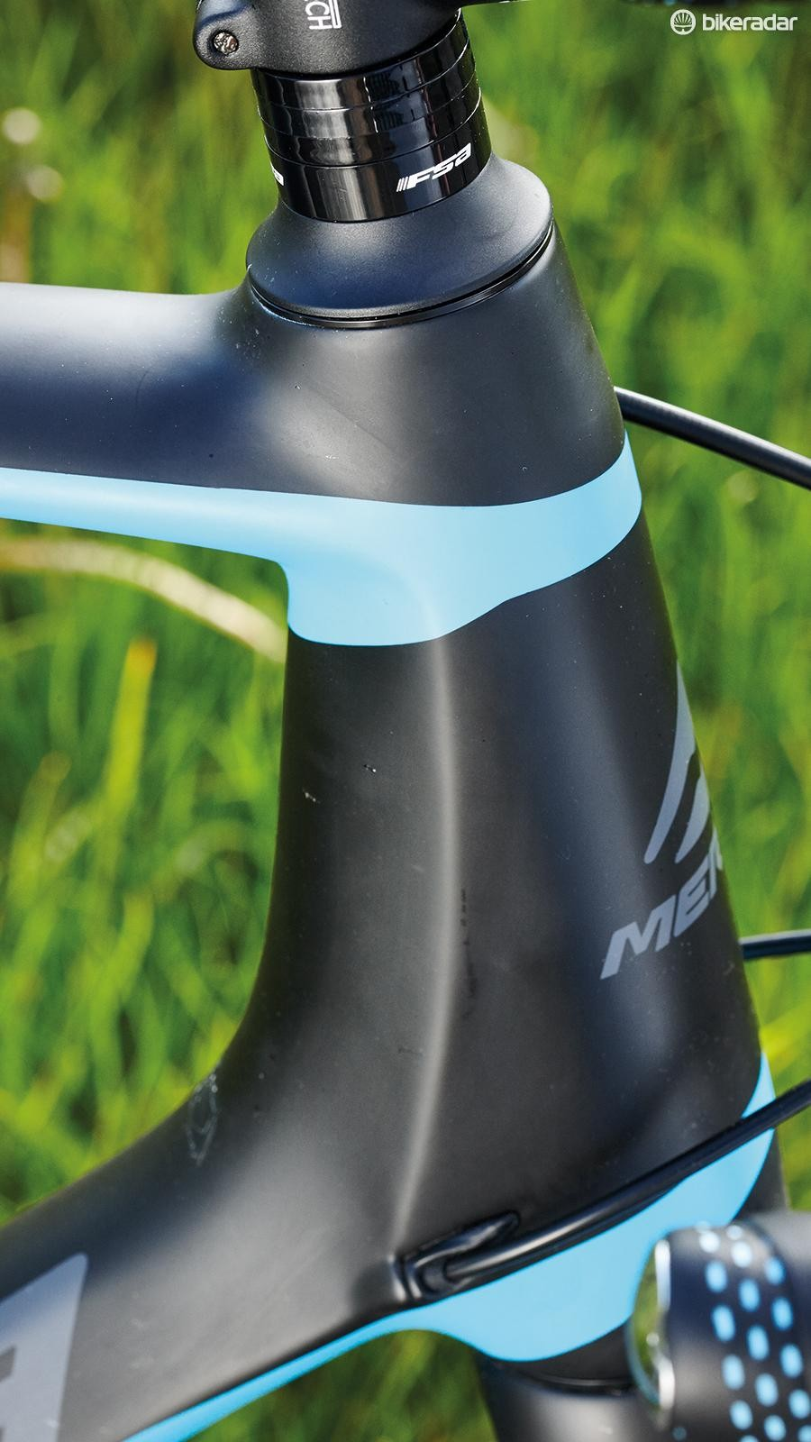 The tapered head-tube features a 1½in lower bearing and houses a lightweight carbon fork