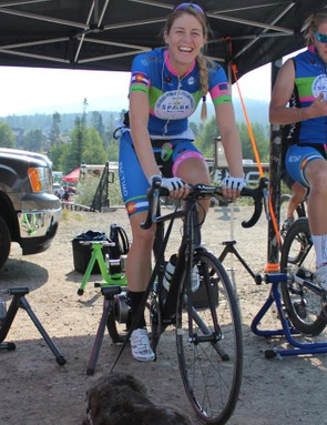 Legan warms up before the Breckenridge TT with her dog, Zeke