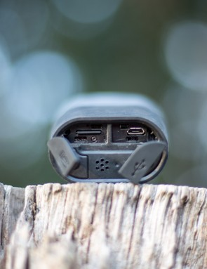 Small weatherproof doors hide the micro-USB charging port and microSD card slot (card included with unit)