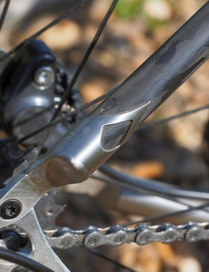 The carbon seatstays are capped with intricately cut titanium tips