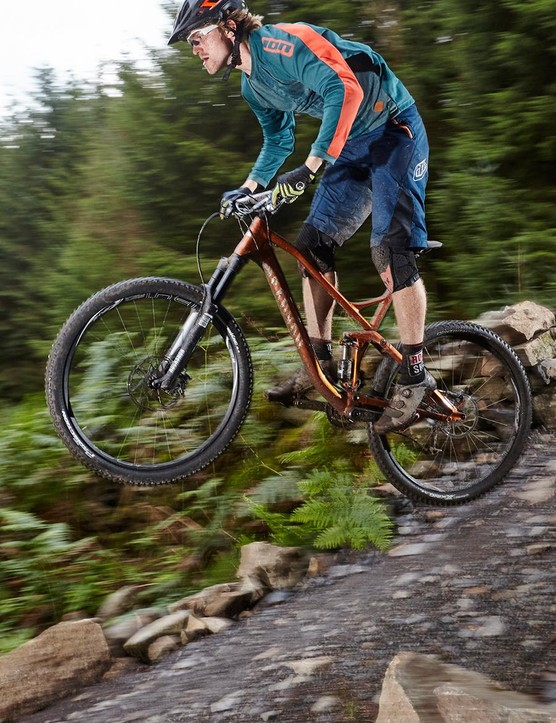 The big 29in wheels and chunky tyres allow the Spectral to really motor over rough terrain