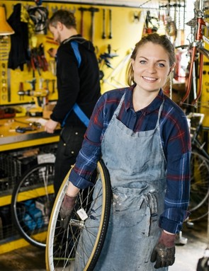 There's a positive correlation between the number of women working at a bike shop, and the number of female customers