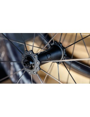 Enve carbon road hubs blend one-piece carbon with DT Swiss internals and Ceramic Speed bearings. Yes, please