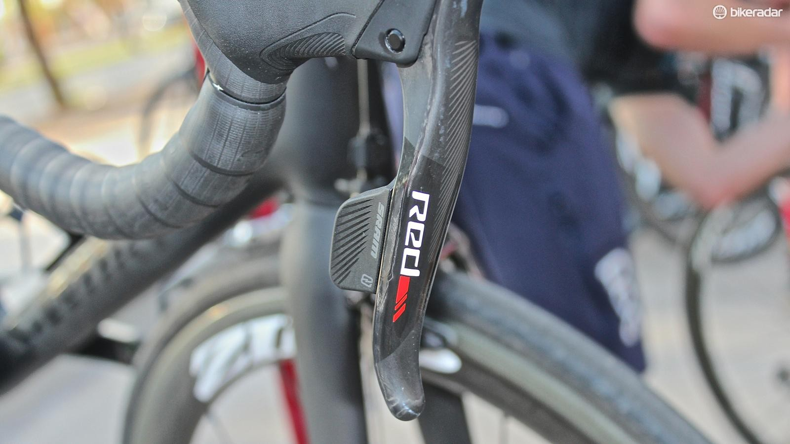 SRAM Red eTap uses a single wireless button on each lever to control the front and rear derailleurs