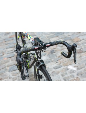 Shimano Dura-Ace Di2 sprint shifters are tucked just under and inboard of the hoods