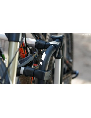 The frame clamps clip onto the rear of the rack. When loosened, you can pull them free for easy feeding through frames