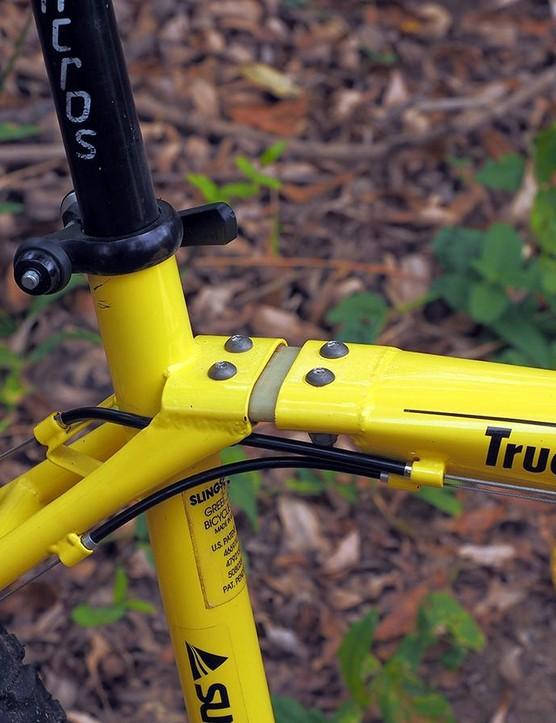Back near the seat tube is a slightly flexible fiberglass 'dogbone' hinge