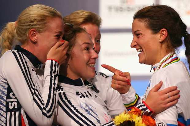 Smiles all round as Lizzie Armitstead is congratulated by teammates