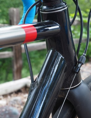 The tapered head tube is TIG-welded to an ovalized top tube and a teardrop-profile down tube. All of the tubes are slightly oversized for a distinctly efficient-feeling ride