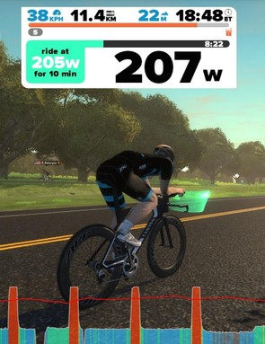 The bar graph at bottom shows intervals in red and rest in blue —a similar layout to TrainerRoad