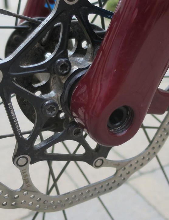 The front all-carbon fork uses thru-axles