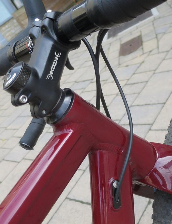 The geometry is designed around using a shorter (by 30mm) stem than a standard bike. This keeps the steering sharp despite the slacker head angle